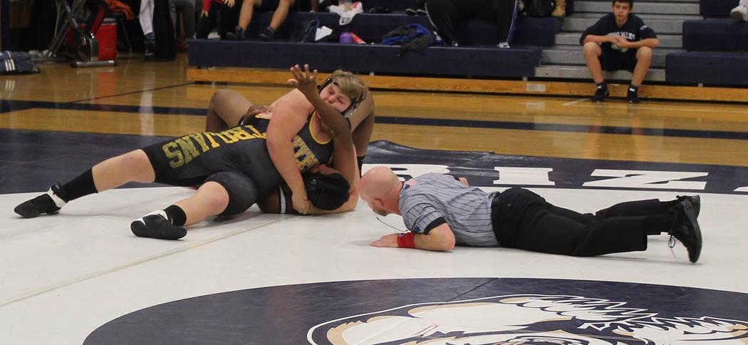 Tom Rysinski/Pahrump Valley Times Pahrump Valley freshman Tanner Hanks closes in on a pin of An ...