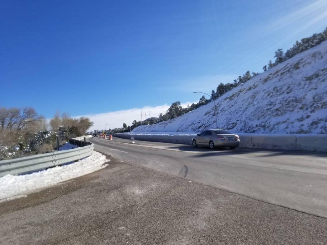 David Jacobs/Pahrump Valley Times A vehicle passes through Nevada Highway 160 in the Mountain S ...
