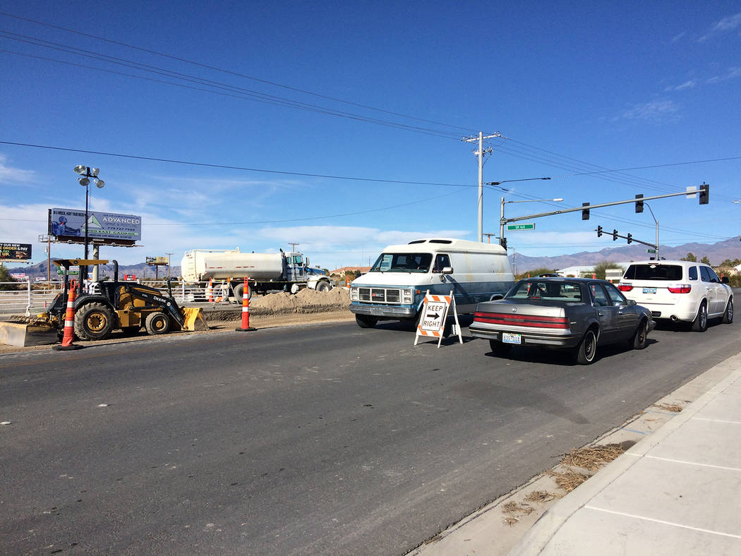 Robin Hebrock/Pahrump Valley Times Vehicles are shown traveling on Homestead Road at Highway 16 ...