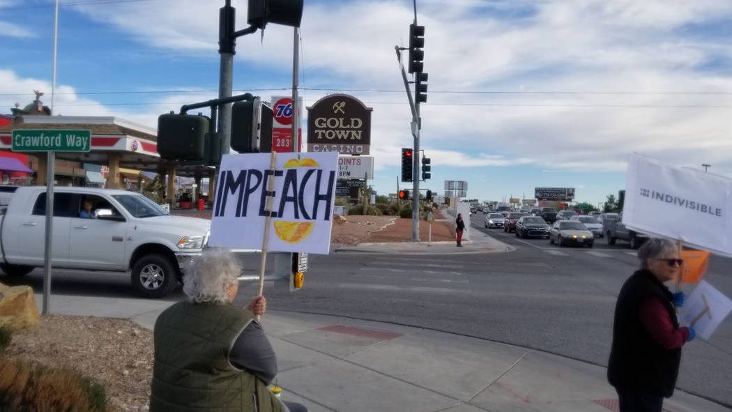 David Jacobs/Pahrump Valley Times Protesters opposing President Donald Trump are shown gatherin ...