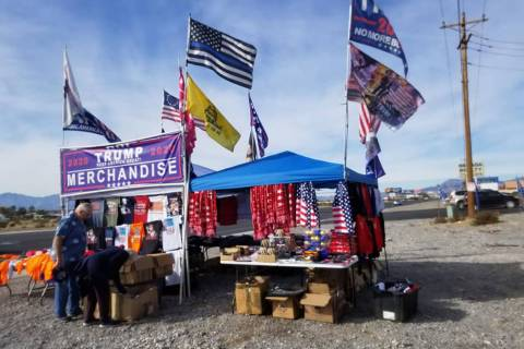 David Jacobs/Pahrump Valley Times A couple visits the traveling Donald Trump merchandise store ...