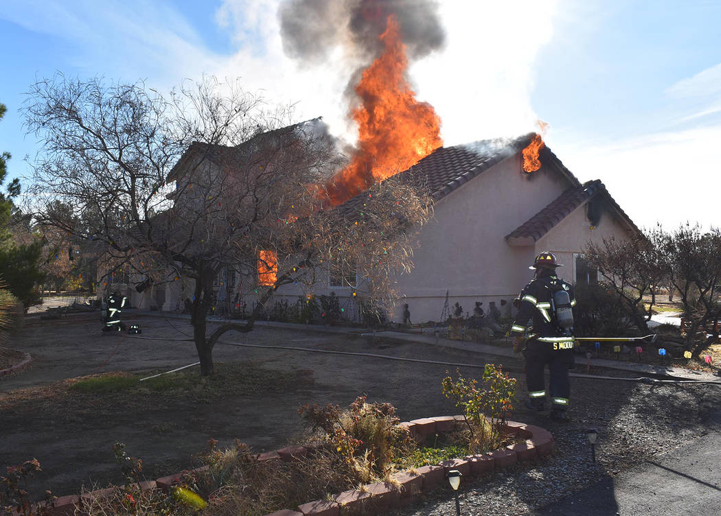 Special to the Pahrump Valley Times Pahrump fire crews were met with heavy fire conditions upon ...