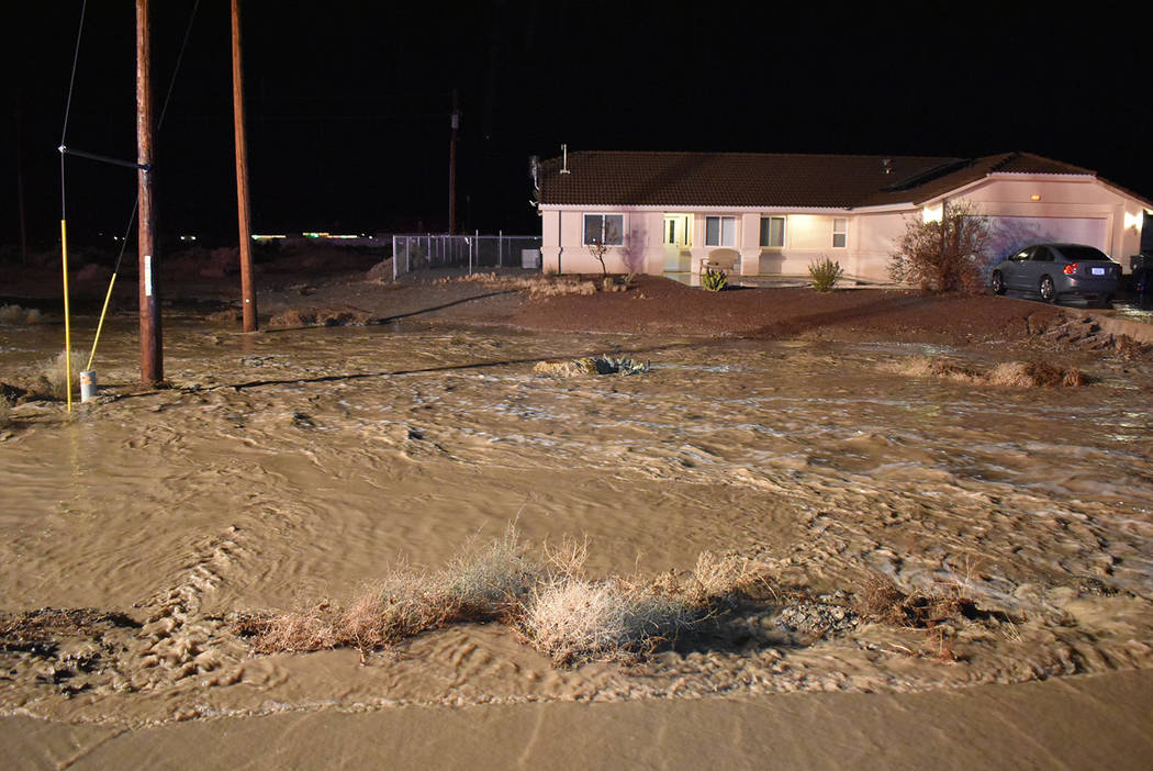 Special to the Pahrump Valley Times Heavy rains on Sunday night Dec. 8, caused major flooding i ...