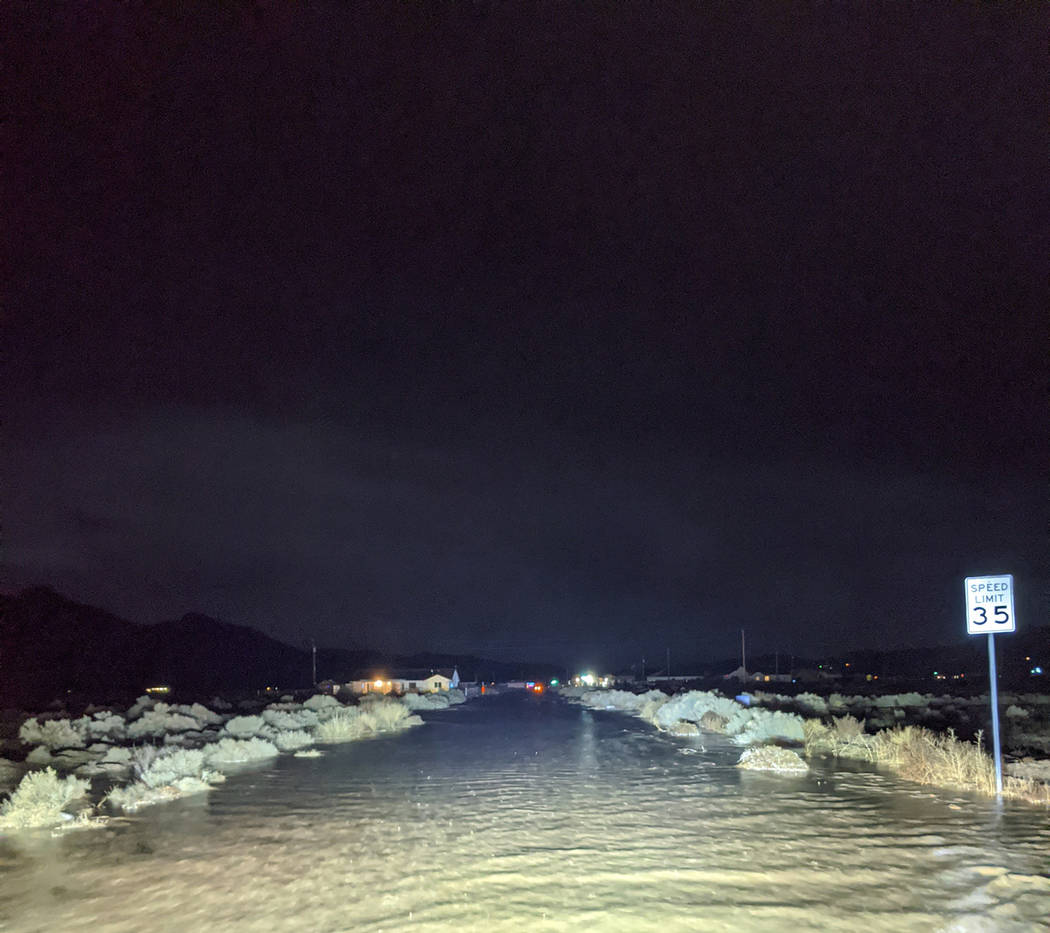 Charlotte Uyeno/Pahrump Valley Times Flooded streets created serious driving hazards for reside ...