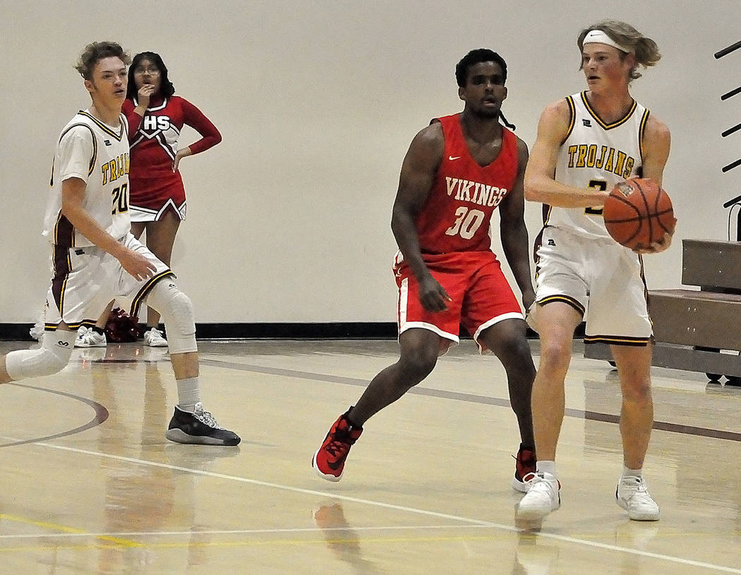 Horace Langford Jr./Pahrump Valley Times Senior guard Grant Odegard looks to pass around Valley ...