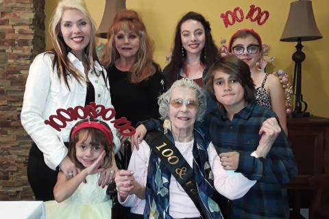 Selwyn Harris/Pahrump Valley Times Dottie Collins, who turned 100 years-old this week, is surro ...