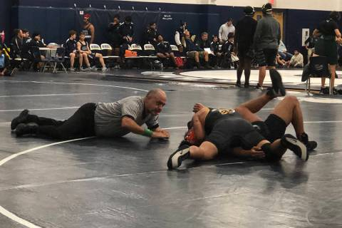 Tom Rysinski/Pahrump Valley Times The referee moves in to signal a fall for Pahrump Valley juni ...
