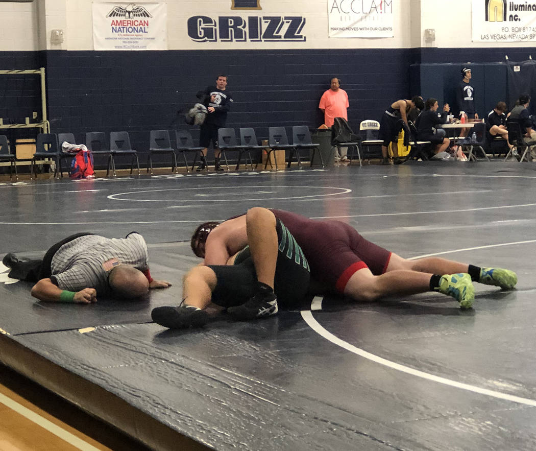 Tom Rysinski/Pahrump Valley Times Heavyweight Jared Mudge battles to keep his Palo Verde oppone ...