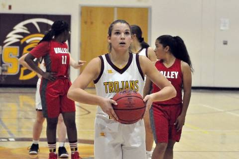 Horace Langford Jr./Pahrump Valley Times Junior Maddy Souza at the line against Valley on Dec. ...