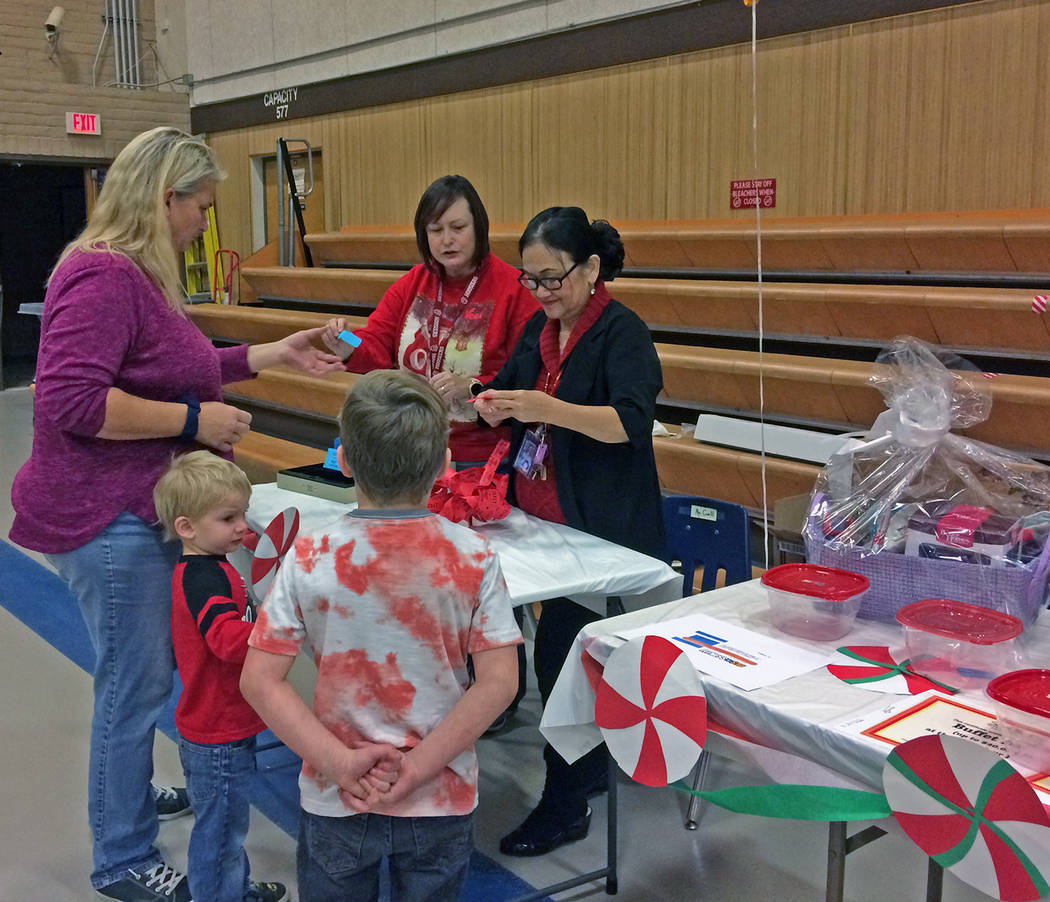 Robin Hebrock/Pahrump Valley Times A local family purchases a raffle ticket for the gift basket ...