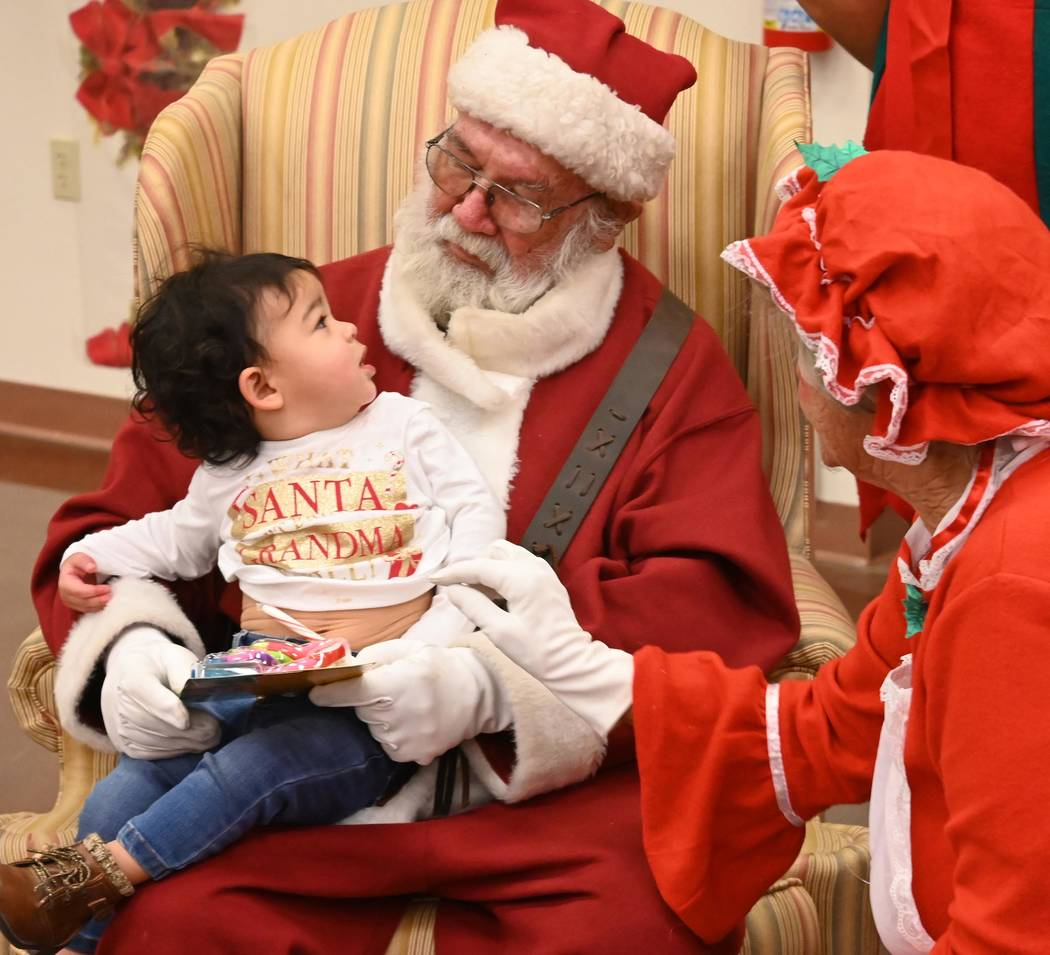 Richard Stephens/Special to the Pahrump Valley Times This baby appears to be captivated by Sant ...