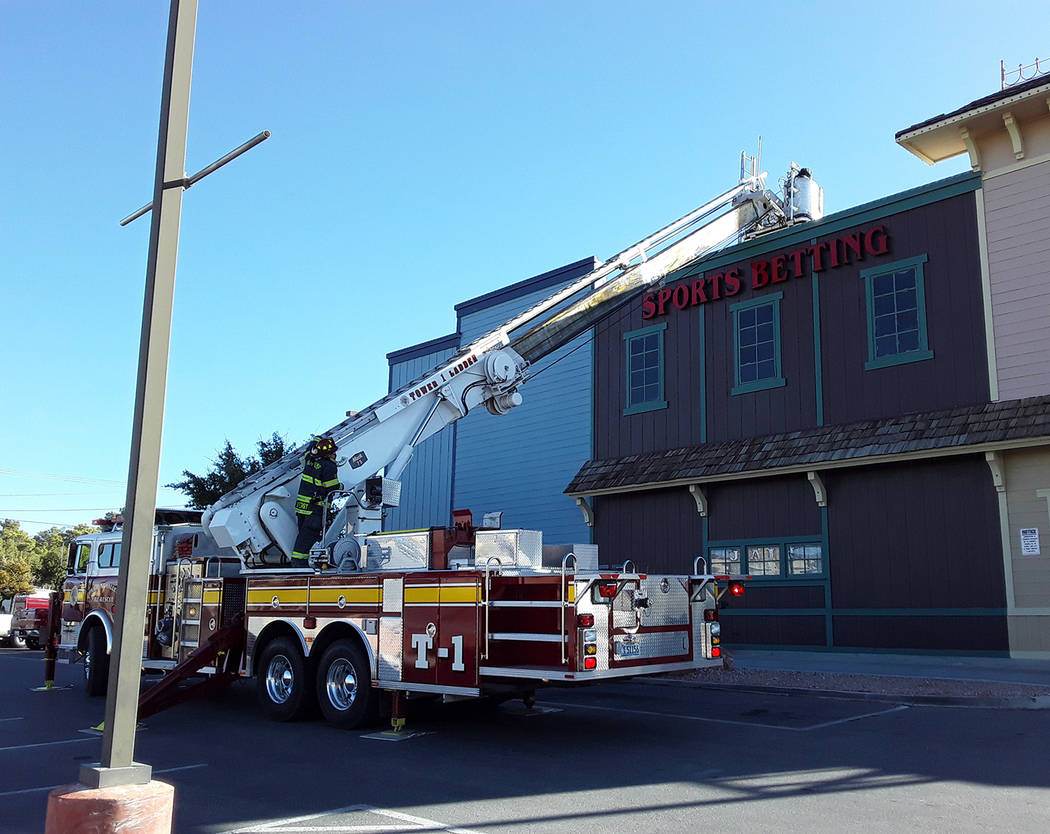Selwyn Harris/Pahrump Valley Times A Pahrump Valley Fire and Rescue Services crew member access ...