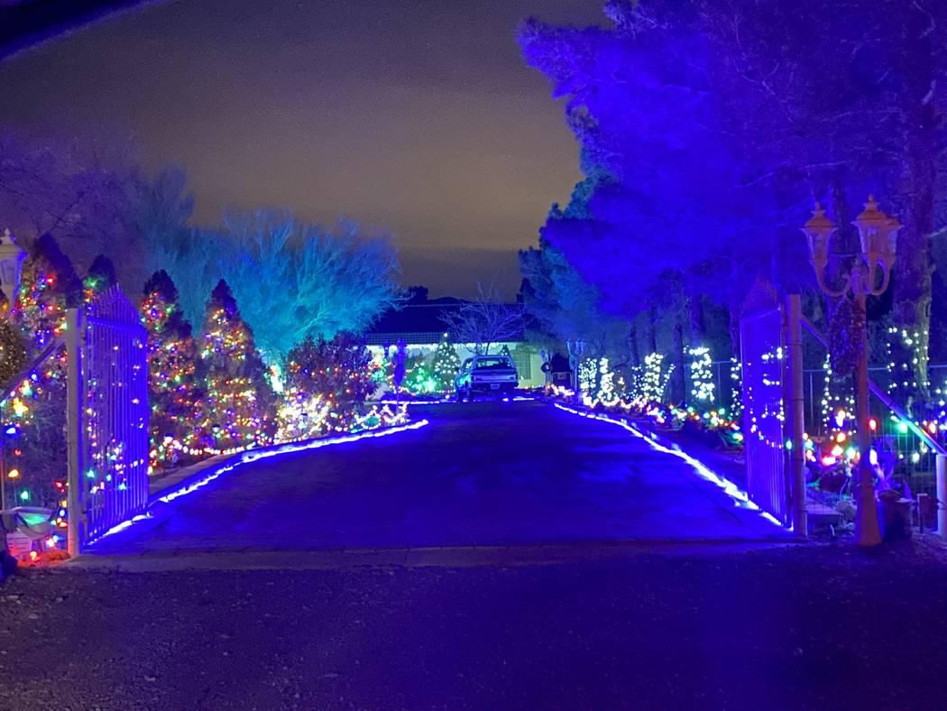 Jeffrey Meehan/Pahrump Valley Times Ron and Sonja Cordova put their large Christmas light disp ...