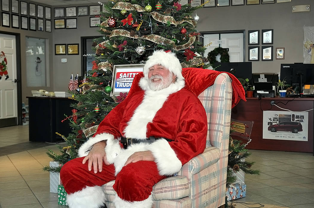 Horace Langford Jr./Pahrump Valley Times Santa visits the Saitta Trudeau car dealership on as ...