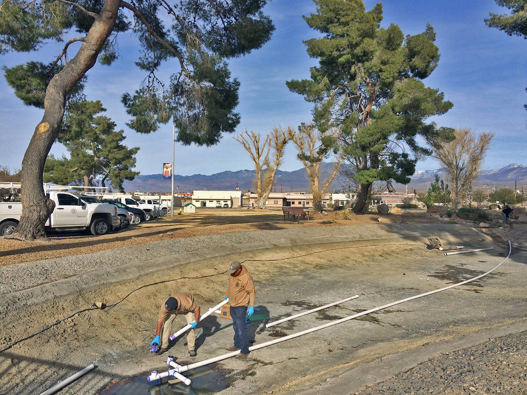 Robin Hebrock/Pahrump Valley Times Buildings and grounds crews are seen installing new pipes in ...