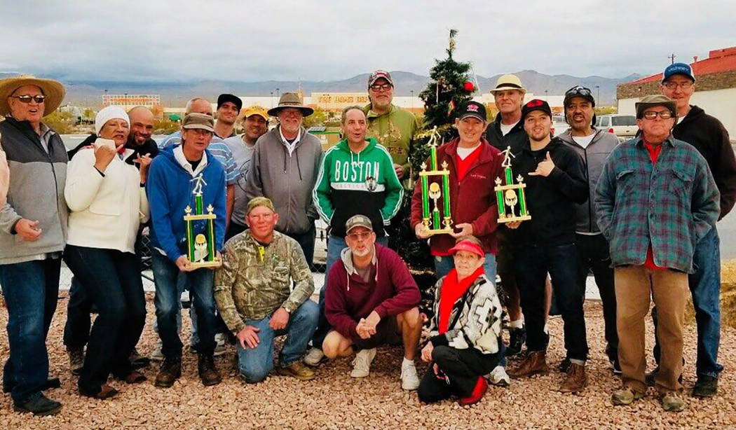Kim Dilger/Special to the Pahrump Valley Times Participants gather after the Christmas Tree Ope ...