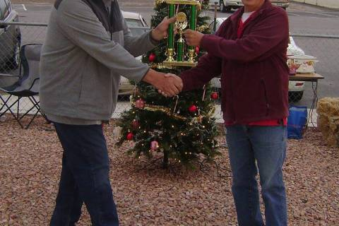 Mike Norton/Special to the Pahrump Valley Times Dennis Andersen, left, hands the first-place tr ...
