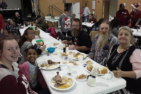 Selwyn Harris/Pahrump Valley Times A local family enjoys a special Christmas dinner on Tuesday ...