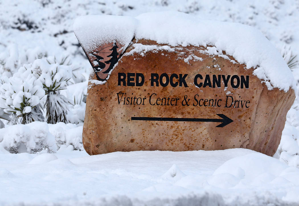 Heidi Fang /Las Vegas Review-Journal The Red Rock Canyon marker at Route 159 is covered in snow ...