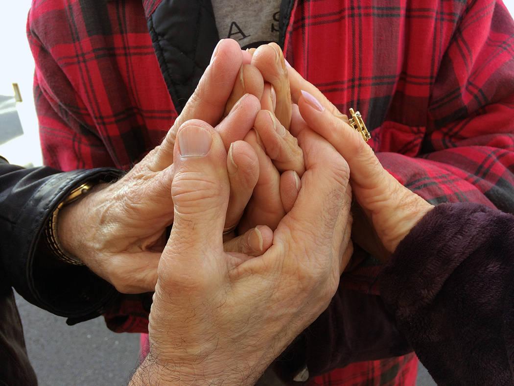 Robin Hebrock/Pahrump Valley Times Pahrump residents Tony Lambardi and Toni Garrison clasp hand ...