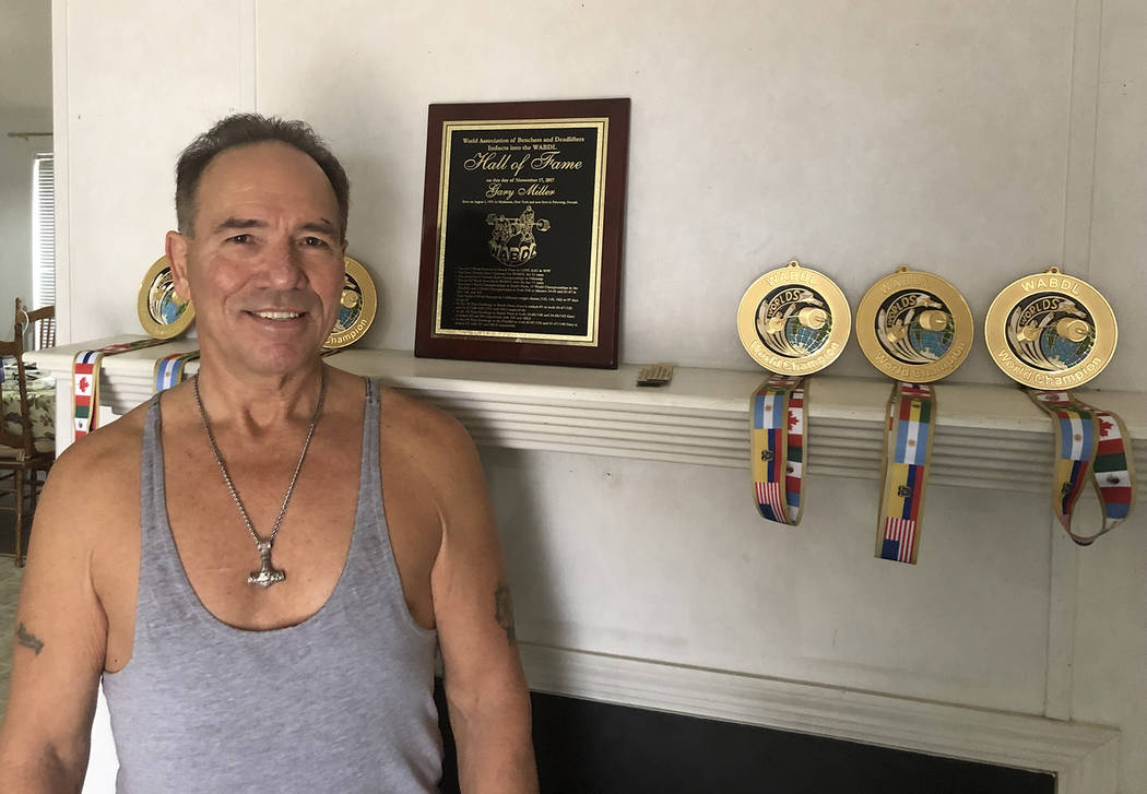 Tom Rysinski/Pahrump Valley Times Gary Miller with medals for his three most recent titles and ...