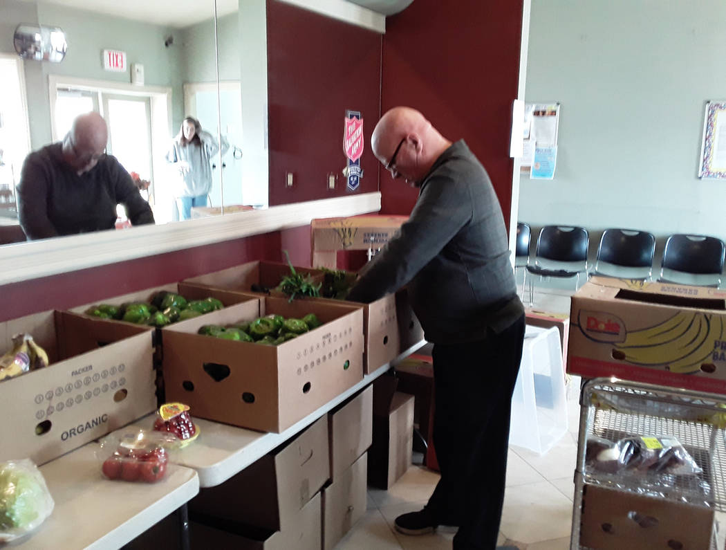 Selwyn Harris/Pahrump Valley Times Pahrump Salvation Army Pastor Jon Watt unloads various food ...