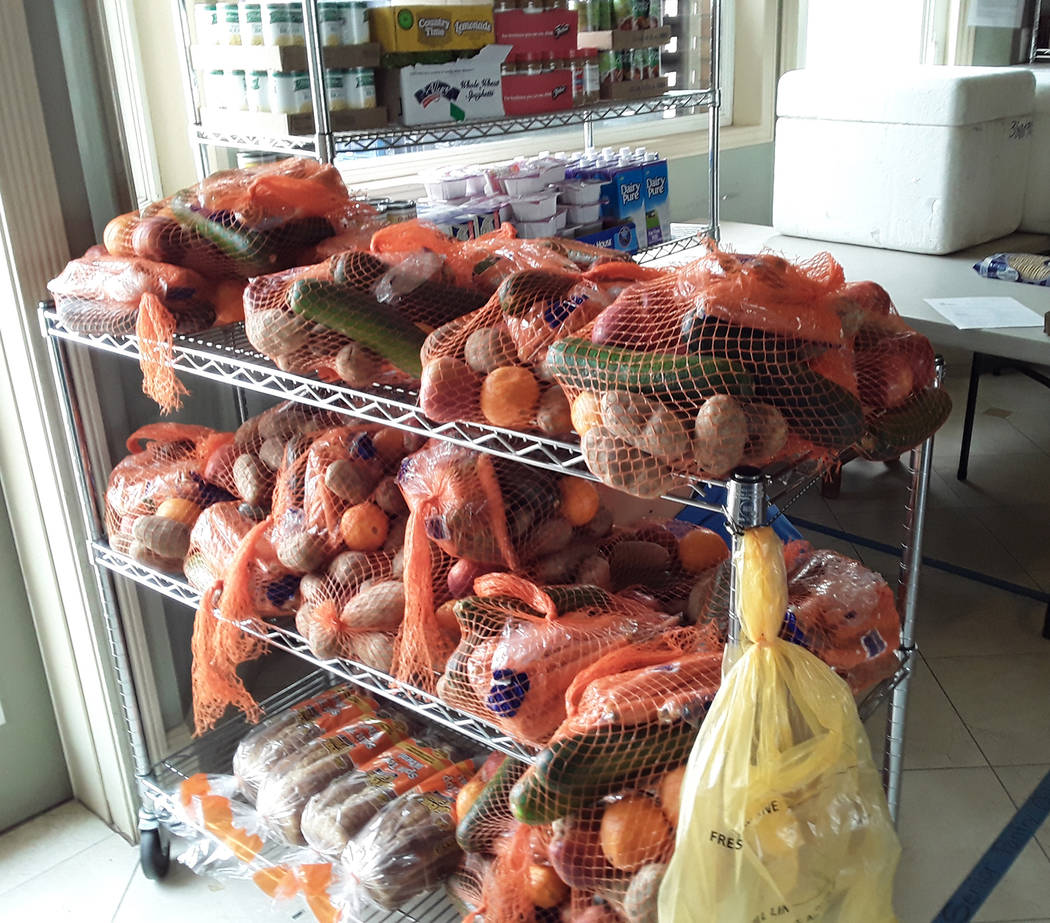 Selwyn Harris/Pahrump Valley Times Recipients for the Golden Groceries food program must be at ...