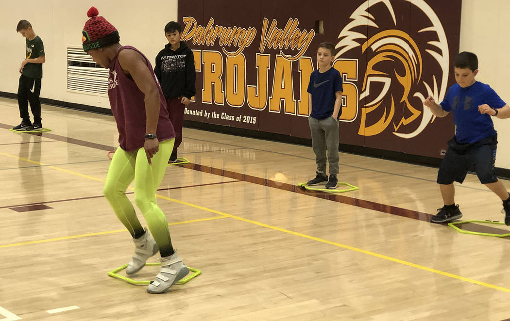 Tom Rysinski/Pahrump Valley Times Dominique Maloy demonstrates the footwork needed to do a dril ...