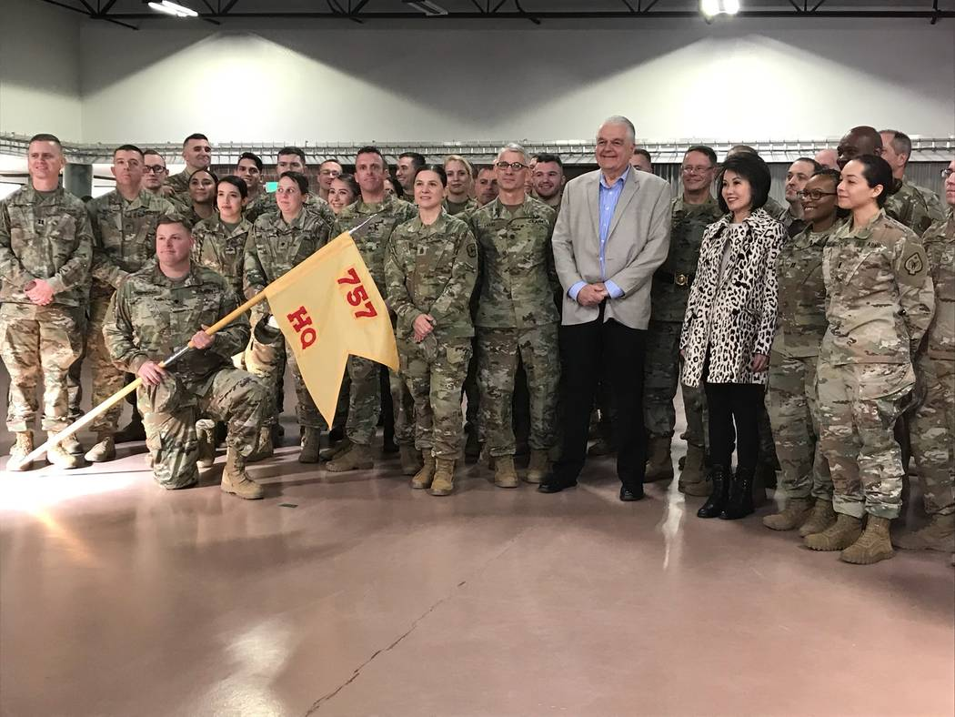 Gov. Steve Sisolak and first lady Kathy Sisolak pose with departing soldiers from the Nevada Ar ...