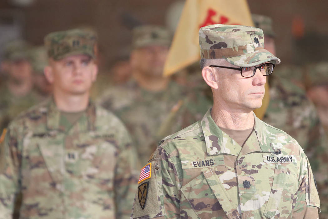 Steve Ranson/Nevada News Group Soldiers stand at ease Friday's mobilization ceremony for the ...