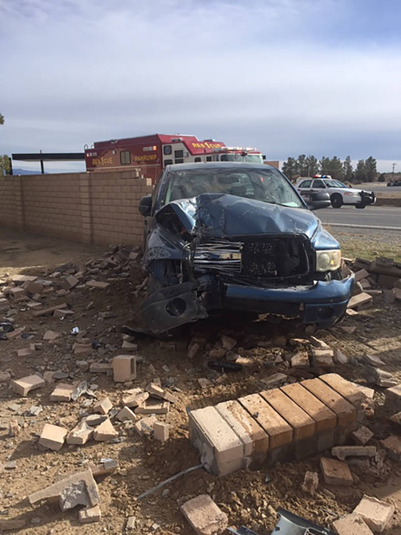 Special to the Pahrump Valley Times A driver was arrested after crashing through a block wall c ...