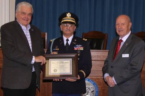 Steve Ranson/Nevada News Group Gov. Steve Sisolak, left, presents the December Veteran of the M ...