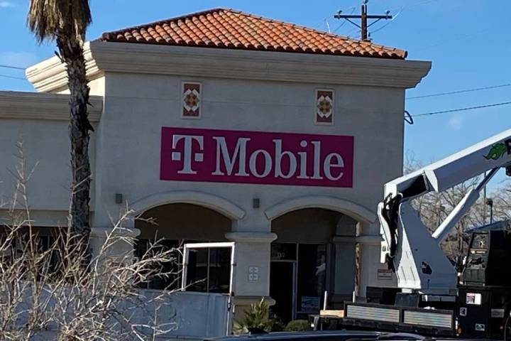 Jeffrey Meehan/Pahrump Valley Times T-Mobile works to open a new store at 20 S. Highway 160 at ...