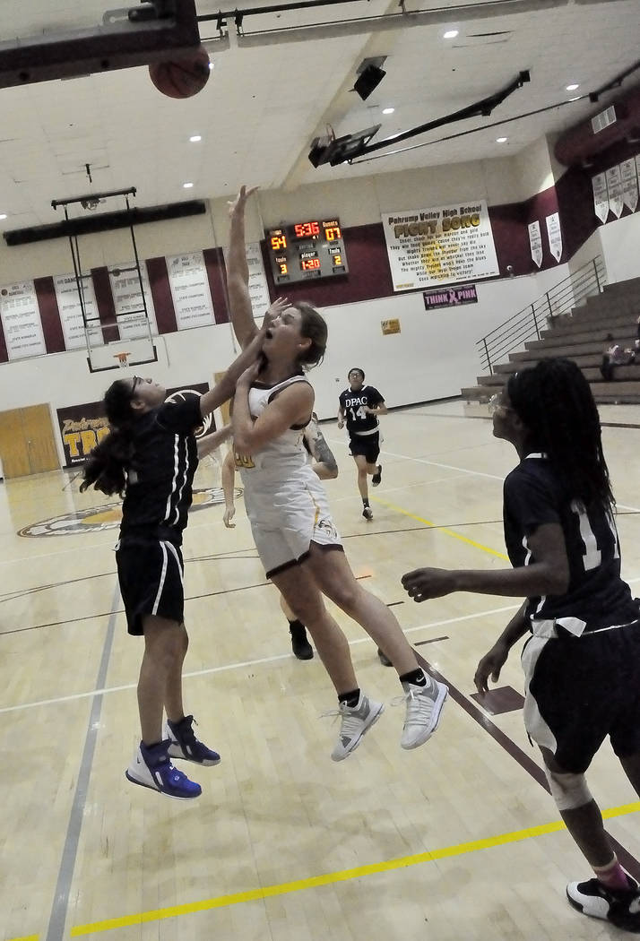 Horace Langford Jr./Pahrump Valley Times Junior guard Maddy Souza attacks the basket during Mon ...