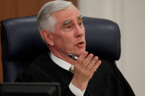 John Locher/Las Vegas Review--Journal District Judge James Todd Russell speaks in his court in ...
