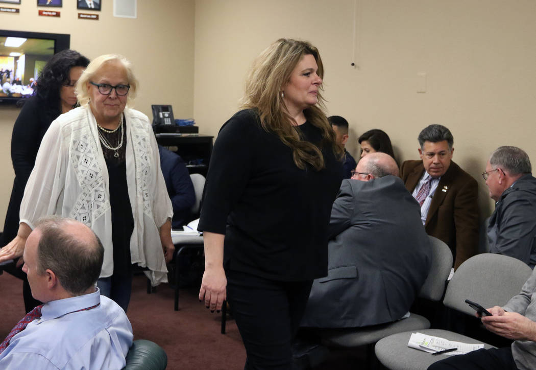 Melanie Bernstein Chapman, right, general counsel of the Nevada Board of Dental Examiners, leav ...