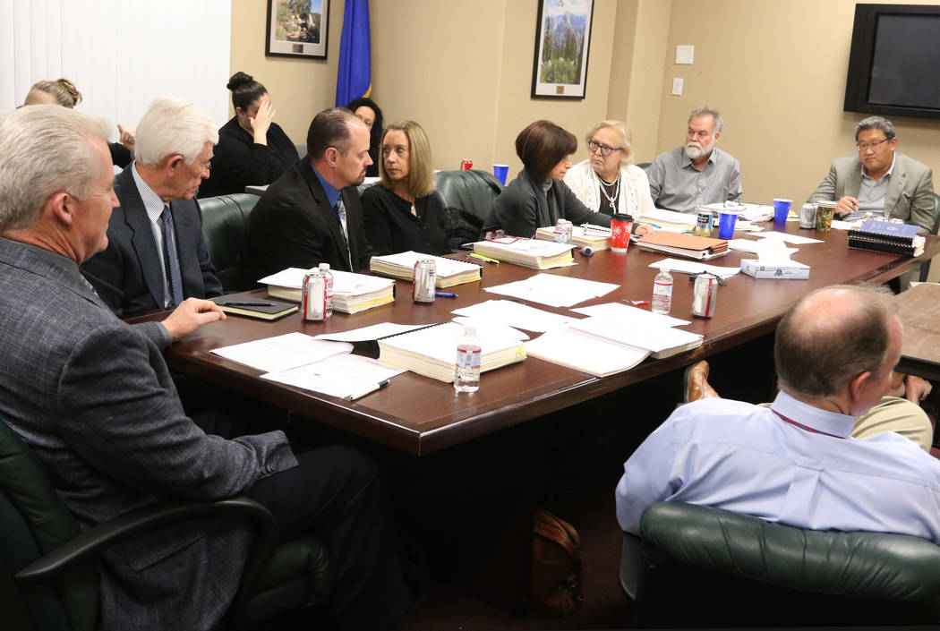 Nevada Board of Dental Examiners members, including David Lee, the new secretary-treasurer, far ...