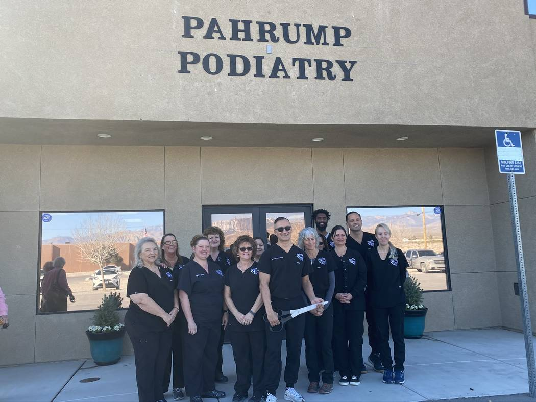 Jeffrey Meehan/Pahrump Valley Times The staff of Pahrump Podiatry stand in front of the company ...