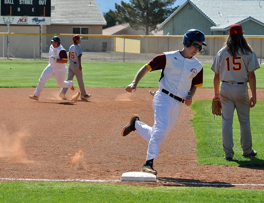 Horace Langford Jr./Pahrump Valley Times Chase McDaniel rounds third base and heads for home fo ...
