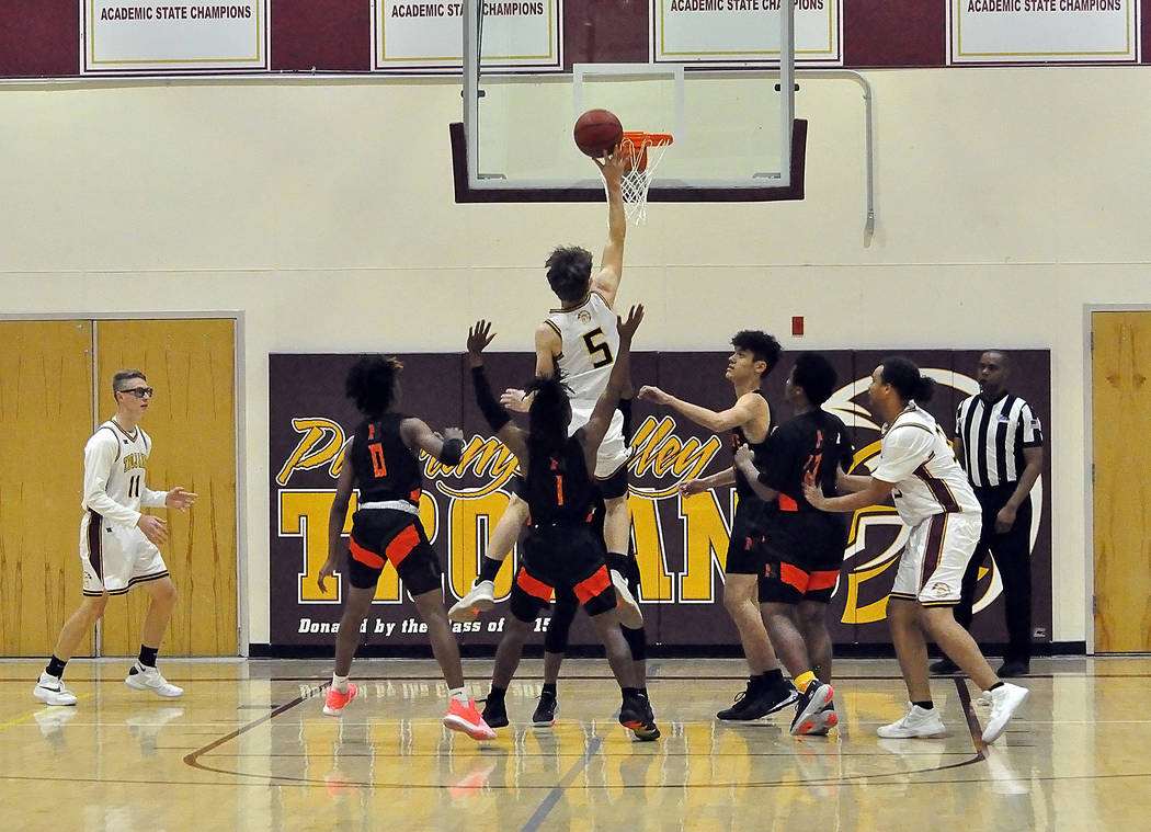 Horace Langford Jr./Pahrump Valley Times Surrounded by Mojave defenders, Pahrump Valley junior ...
