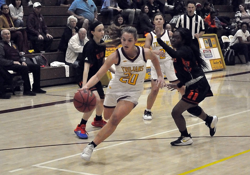 Horace Langford Jr./Pahrump Valley Times Maddy Souza drives against the Mojave defense during P ...