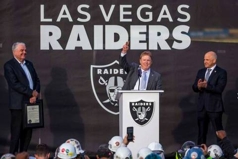 L.E. Baskow/Las Vegas Review-Journal Gov. Steve Sisolak, left, looks to Las Vegas Raiders owner ...