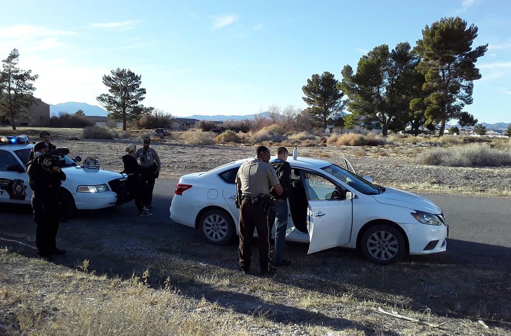 Selwyn Harris/Pahrump Valley Times Two people were taken into custody after Nye County Sheriff' ...
