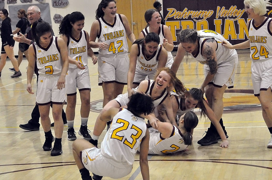 Horace Langford Jr./Pahrump Valley Times Sophomore Tayla Wombaker (2) gets mobbed by Pahrump Va ...