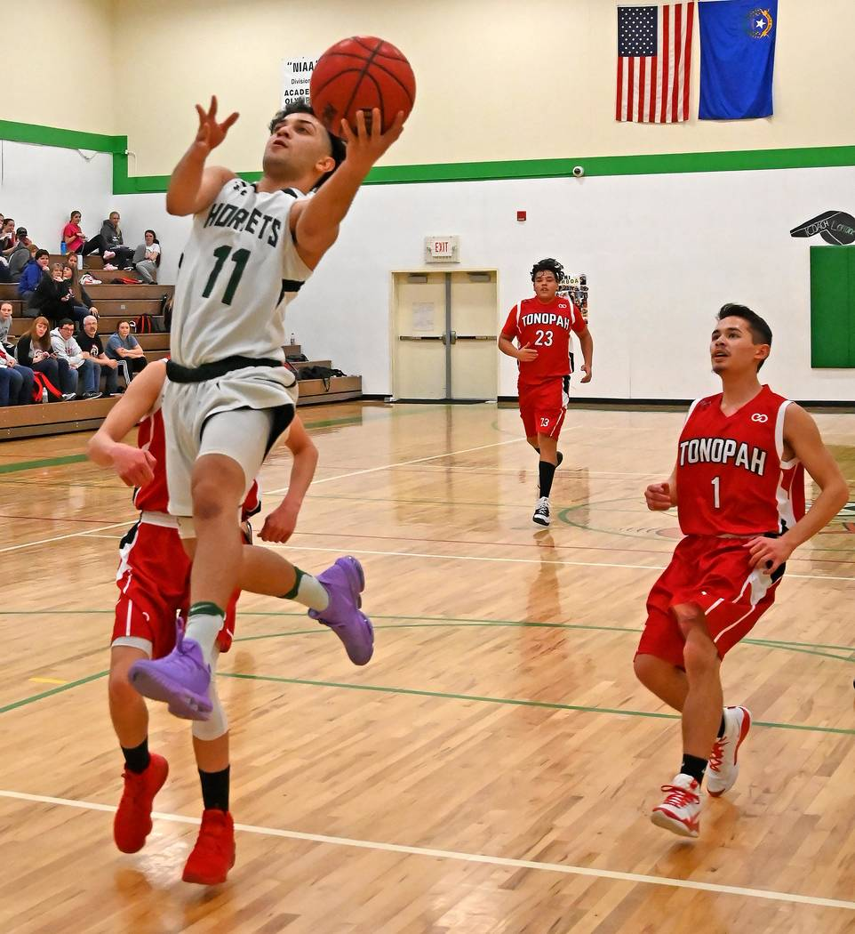 Richard Stephens/Special to the Pahrump Valley Times Beatty senior guard Fabian Perez drives to ...