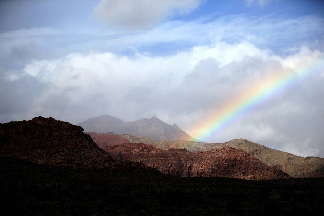 Clouds and a rainbow in Red Rock Canyon National Conservation Area near Las Vegas, Thursday, Ja ...
