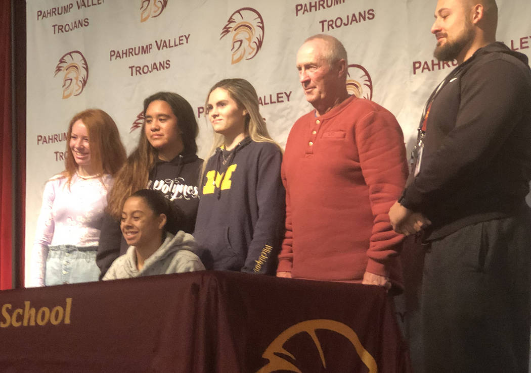 Tom Rysinski/Pahrump Valley Times Surrounded by teammates and coaches Bob Hopkins and Mike Colu ...