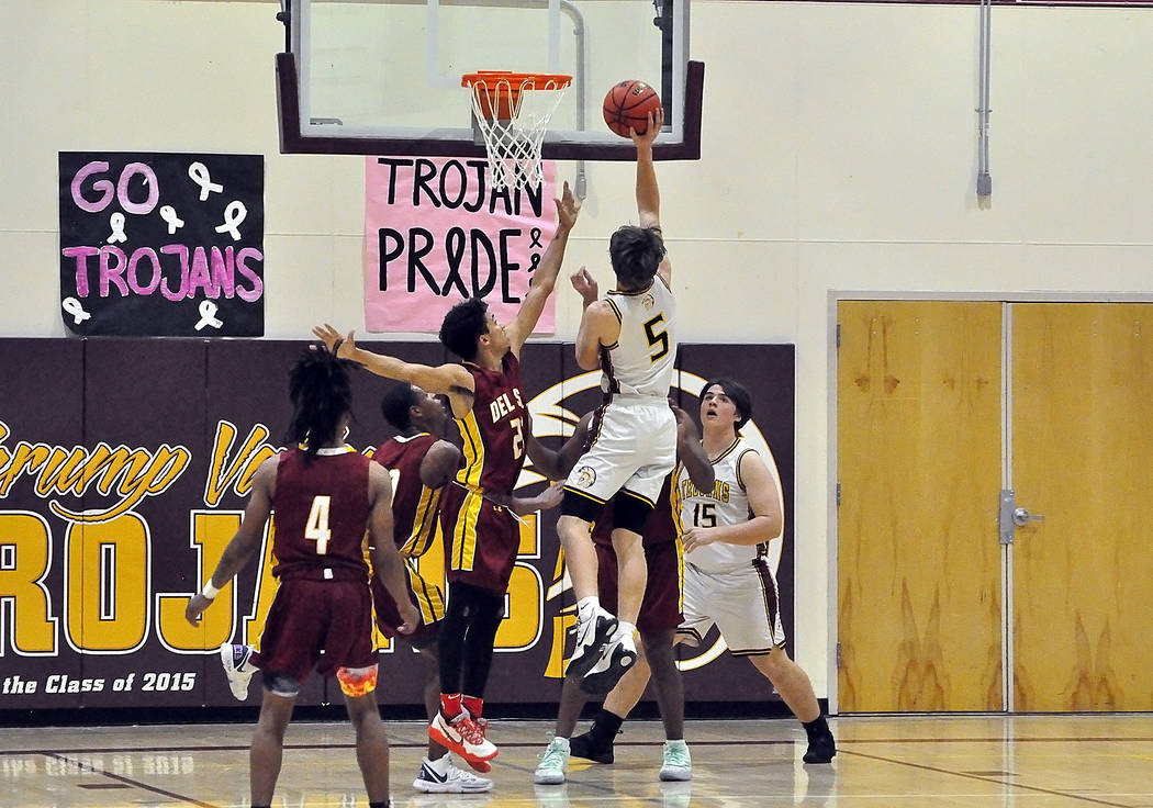 Horace Langford Jr./Pahrump Valley Times Junior Logan Gavenda drives for 2 of his 16 points Tue ...
