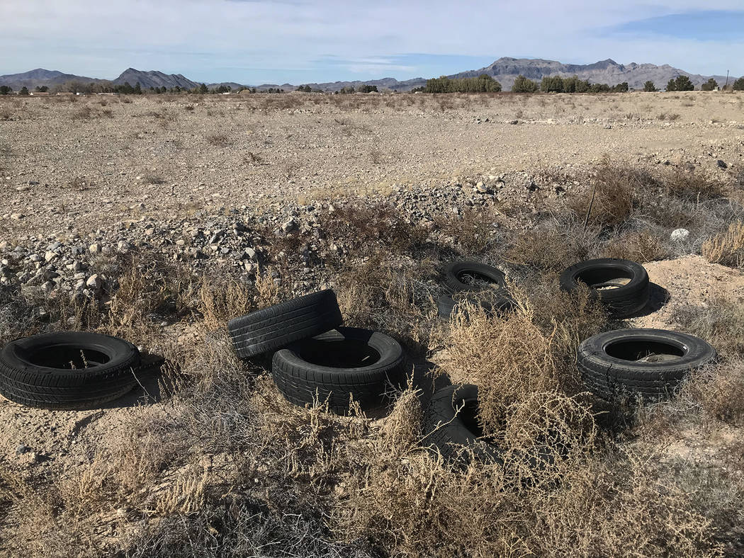 Robin Hebrock/Pahrump Valley Times A pile of discarded tires on the side of one of the few pave ...