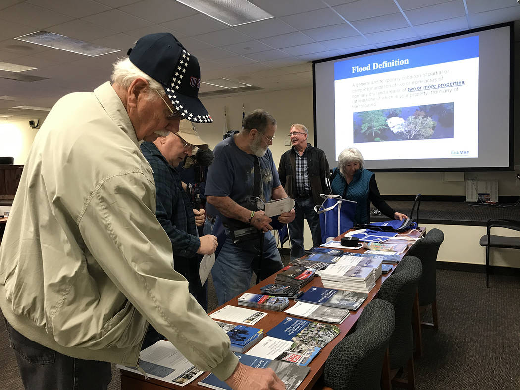Robin Hebrock/Pahrump Valley Times As residents entered the Flood Insurance Rate Map workshop, ...